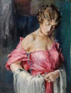 Fortuny painted his wife Henriette Negrin adjusting the silk cords and Murano beads in her own gown. She named the Delphos and is said to have played a major role in creating it. Note the absence of foundation garments.